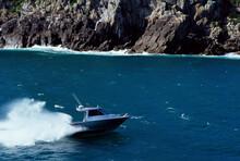 Speed Boat On Calm Water In Mercury Bay