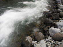 Fast Flowing River Over Rocky River Bed