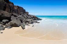 Rocky Cliff And Pristine Sandy Cove At Ballina Head Beach