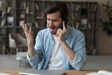 Angry Irritated Man Talking On Phone, Dissatisfied Customer Arguing Or Complaining, Sitting At Work Desk, Mad Unhappy Businessman Solving Problems, Annoyed Young Male Making Call, Screaming