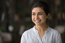 Head Shot Smiling Dreamy Confident Indian Woman Looking To Aside, Successful Businesswoman Visualizing New Opportunities, Happy Attractive Young Female Dreaming About Good Future, Lost In Thoughts