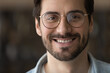 Head shot portrait close up positive bearded man with toothy healthy smile looking at camera, confident businessman in glasses posing for profile picture, happy blogger shooting vlog, recording video
