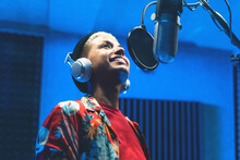 Young  Singer Recording A New Song Album Inside Music Production Studio