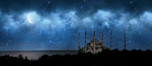 Istanbul, Turkey. Sultan Ahmet Camii Named Blue Mosque. Front View Of Crescent Shaped Moon And Mosque In Front Of Night Cloudy And Starry Sky. Ramadan, The Holy Month Of Muslims. Selective Focus.