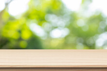 Wooden Table On Green Bokeh Background