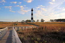 A Wooden Boardwalk Highlights The Beauty Of The Bodie Island Lighthouse In The Outer Banks Of North Carolina.