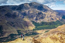 Couple And Their Dog On Haystacks Looking Towards Pillar.  English Lake District.