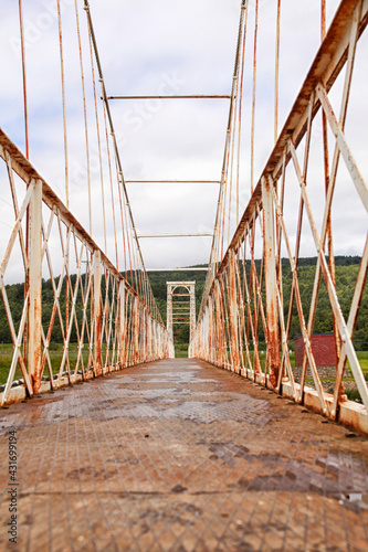Canvas Print Rusty victorian suspension bridge