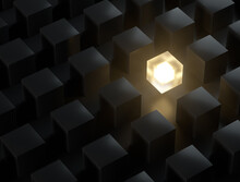 Wallpaper Dark Cubes And One Glowing Light Cube Shining Among Other Dim Cubes In The Dark Background With Reflections And Shadows . 3D Rendering.