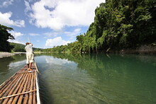 Sailing On A Bamboo Raft On The Rio Grande River. Jamaica.