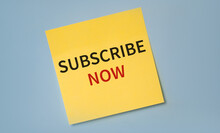SUBSCRIBE NOW Text On A Stciker Against Blue Background.