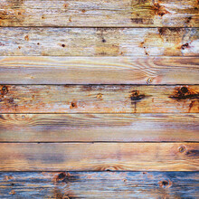 Texture Of The Planks Of An Old Wooden Table In Antiqued Pastel Colors. Vintage Rustic Wooden Background. Carpentry.