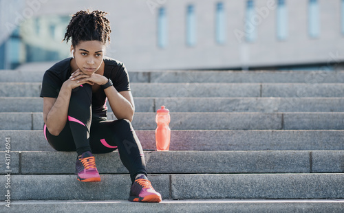 Obraz Relaxing after workout outdoors, jogging in city and taking care of health - fototapety do salonu