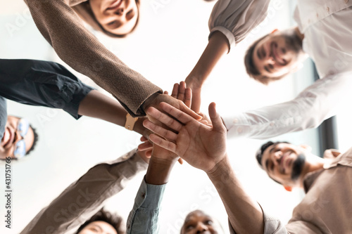Fototapeta Diverse business people putting their hands together in cirle obraz
