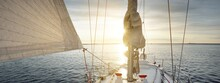 White Yacht Sailing In The Baltic Sea After The Rain At Sunset. Riga, Latvia. Top Down View Of The Deck, Mast And Sails. Dramatic Sky. Sport, Recreation, Leisure Activity, Travel