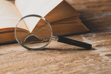 Magnifier And Book.