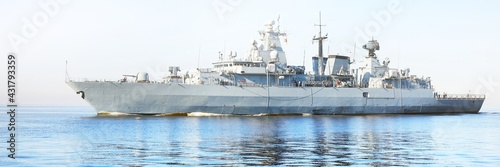 Canvas Large grey modern warship sailing in still water