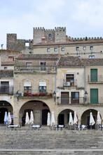 April 2, 2021 In Trujillo, Spain. Stone Houses In The Main Square Of Trujillo Where The Statue Of Francisco Pizarro Is