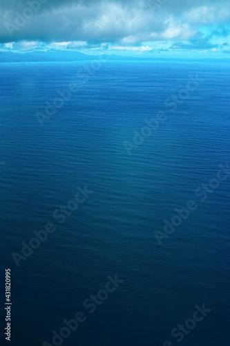 Fotografia 海の彼方に見える半島