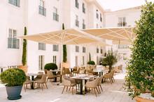 Street Cafe Under Sun Umbrellas In Perast, Montenegro.