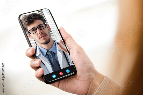 Patient making video call with doctor online via mobile phone, home medical consulation service and telemedical concepts - fototapety na wymiar
