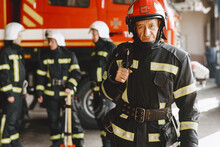 Firefighter Stands At A Meeting Of A Fire Truck