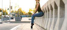 Artist Woman Dancer In Casual Clothes Performs On The Street Happily And Freely Surrounded By City Traffic