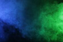 Smoke In Blue Green Light On Black Background