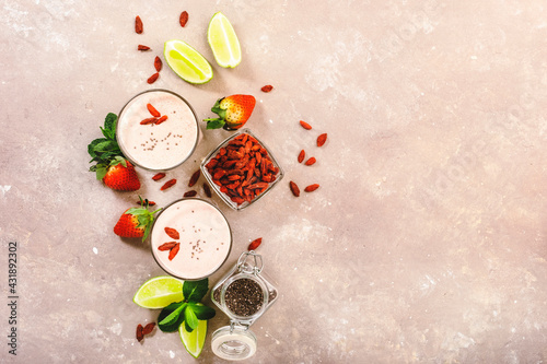 Obraz Healthy blended diet smoothie drink with strawberry and goji berries, chia seeds and lime. Top view - fototapety do salonu