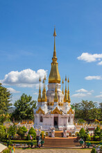 White And Golden Chedi Of Wat Tham Khuha Sawan In Khong Chiam, Thailand