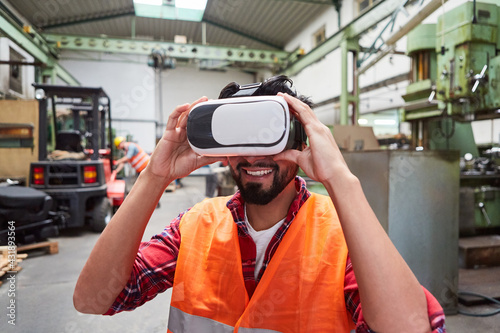 Fototapeta Workers with VR glasses simulating the factory of the future obraz