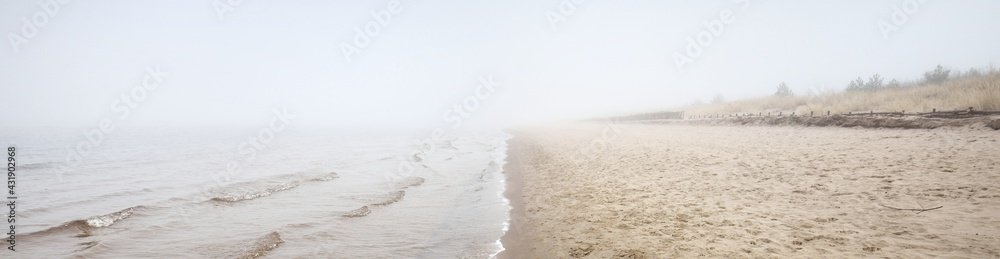 Leinwandbild Motiv - Alex Stemmer : Sandy shore of the Baltic sea in a thick white morning fog. Early spring in Latvia. Idyllic rural scene. Nordic walking, recreation, eco tourism, environmental conservation concepts