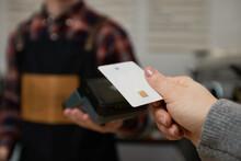 Customer Hand Holding Credit Card Near Nfc Terminal.
