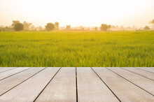 Empty Old Wooden Table In Front Of Blurred Beautiful Organic Rice Field And Mountain With Beautiful Sunrise Background Of Nature. Can Be Used For Display Or Montage For Show Your Products.