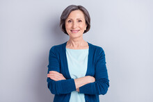 Photo Of Adorable Charming Age Woman Wear Blue Cardigan Smiling Arms Folded Isolated Green Color Background
