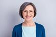 Leinwandbild Motiv Photo of sweet charming age woman wear blue cardigan glasses smiling isolated green color background