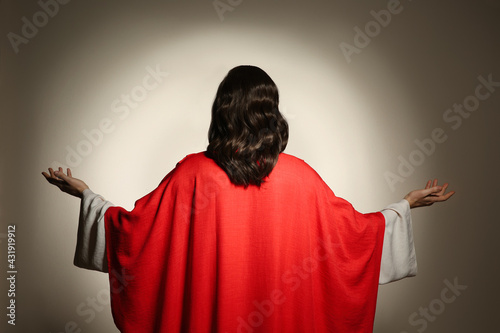 Fotografia, Obraz Jesus Christ with outstretched arms on beige background, back view