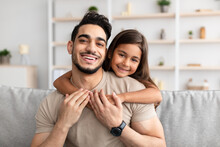 Portrait Of Father And Daughter Hugging At Home