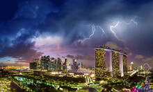 Arial View Of Singapore From Drone, View From Gardens By The Bay During A Storm