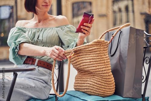 Obraz Woman getting wet napkins from bag - fototapety do salonu