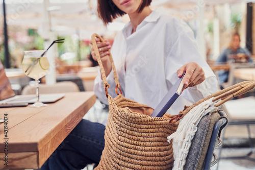 Obraz Close up of girl opening her bag - fototapety do salonu