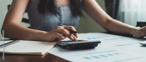 Photo Business woman working in finance and accounting Analyze financial budget with c