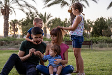 Family Spending Leisure Time Together At Park