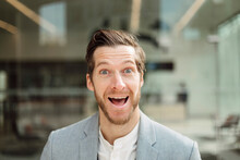 Cheerful Businessman With Mouth Open