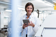 Smiling Female Scientist With Digital Tablet At Laboratory