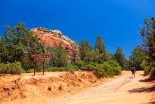 Male Hiker Walking On Devil`s Bridge Trail, Red Rocks, Sedona, Arizona, USA