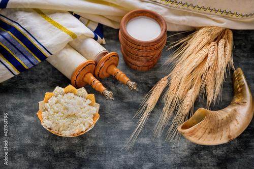Fototapeta Torah and kippah on celebration Jewish Holiday Shavuot for Kosher dairy product obraz