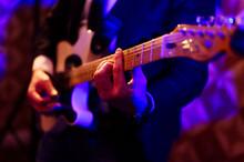 Male Guitarist Playing Guitar At Studio