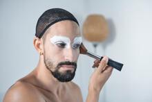 Man Wearing Hair Net Setting Cheek With Face Powder Brush