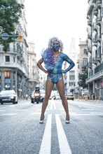 Drag Queen Standing With Arms Akimbo On Street In City